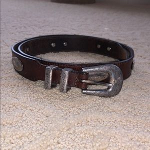 Brown leather belt with silver embellishments